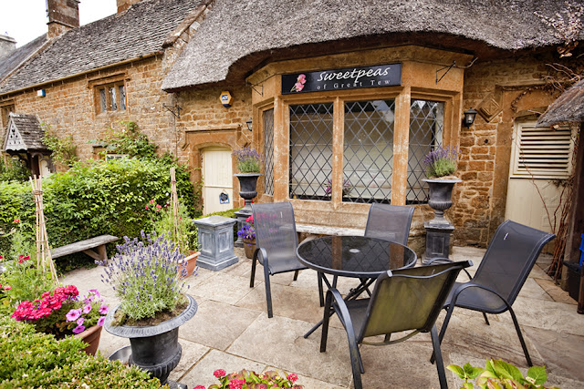 Outside seating at the Cafe in Great Tew in the Cotswolds by  Martyn Ferry Photography
