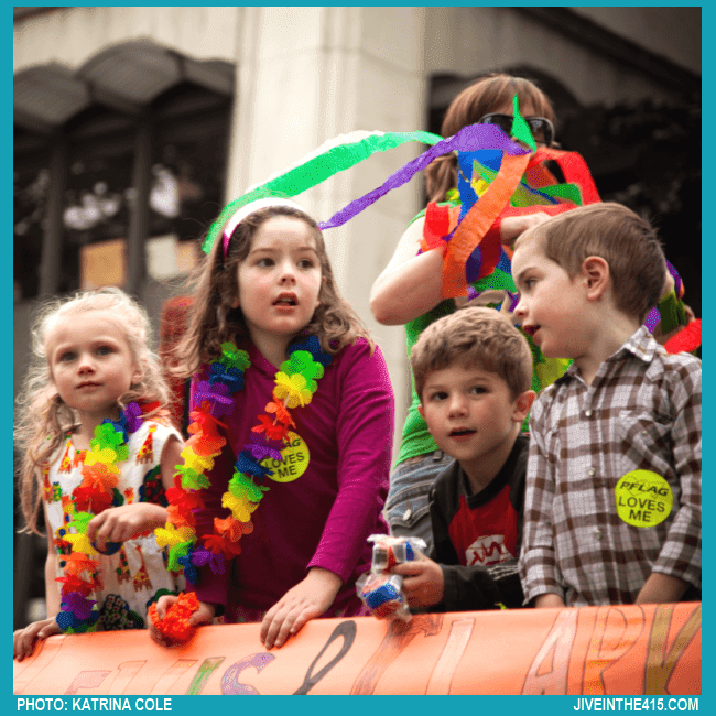 Some young kids are enthralled by the Portland Oregon Pride Parade