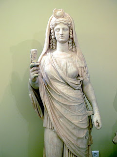 Statue of Isis-Persephone, the queen of  the underworld, holding a sistrum, in the  Archaeological Museum in Herakleion.