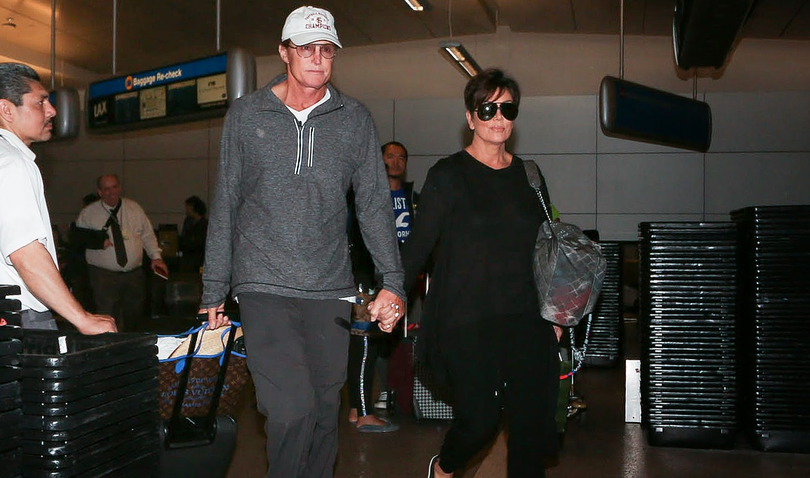 Bruce and Kris Jenner holding hand at LAX