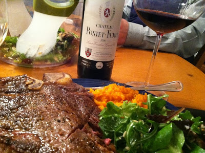 steak grilled with a cumin garlic rub served with a salad and Bordeaux