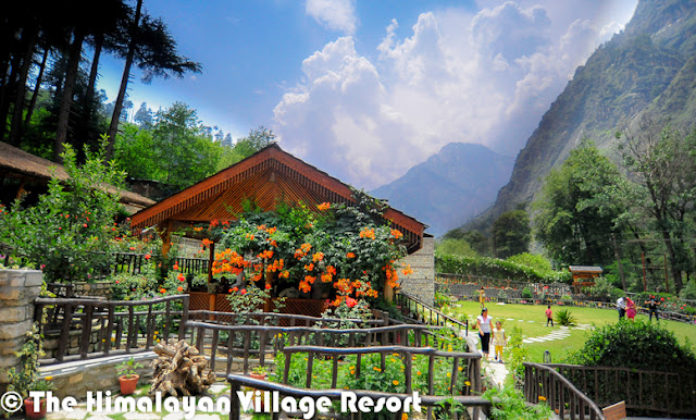 Want to enjoy Chamba, Kinnaur, Mandi, Kangra, Shimla, Spiti, Lahaul and Kullu at the same time? No I am not kidding! You could actually do that at the Himalayan Village Resort.And these are names of the cottages in the quaint resort, and captured the flavors of Himachal – the interiors, the food, entertainment-under one roof The resort, set amidst thick Deodar forest, helps you rediscover yourself, The serene mountain landscape of the land of gods and the unique architecture of Himalayan village resort- made of stone and wood-is so captivating that you many not want to go back to the city and its choresThe resort has been built in the ancient Kathkunia style –dry stacking stones and wood without cement. The inner walls are mud plastered to retain the native rustic charm. The resort is Eco-friendly and gives you an insight in the local customs and traditions. There are 8 cottages including two Machan- style rooms.The decor theme of each of the 750 sq ft cottage is built around the different culture flavors of Himachal Pradesh the decor of each room has been done up thematically, reflecting the tradition and culture of the state –deodar wood work, beautifully carved teak furniture, handmade Tussar silk curtains and traditional brass fittings give each room a cozy feel as you have come home. The resort provide daily housekeeping and evening turn down services.All cottages are equipped with a king size bed,4-seater sofa, study, mini Fridge ,mini bar, separate dressing area, fully furnished and equipped toilets and personal lawn. They also have private sit-outs. Lahaul and Kullu the Machan –Style cottages are the USP of the resort. They offer a sweeping view of the mountain landscape. Book the machans well in advance as they are most sought-after cottage because of their unique setting. The resort has mult-cusine restaurants, a well done up cozy bar that stocks finest liquor from around the world and a fully equipped spa to pamper you. The spa offers heat sauna, steam sauna, Jacuzzi aroma bath therapy, acupressure and massages and kero therapy.In case you planning a business gathering, the resort can accommodate different group size .It has world class facilities for organizing meetings. At the resort, you could be torn between staying indoors and going outdoors. If you are the outdoor types, the hotel can arrange many activities such as river crossing, rappelling, nature walks jungle excursions, rock climbing, mountain biking, trout angling, trekking and river rafting, horse riding, jeep safaris jungle barbecue.In case you feel like lazing around, simply sit in the private garden of your suite and let the sun-rays filtering through the Deodar tree play on you.A holiday at the resort and the cool greenness of Kullu with its wide range of trees, ferns and native flora will act like balm for your dust-weary soul. That's a promise!Just look at the right-bottom corner of above photograph, which shows the location on a hill where 'The Himalayan Village Resort'  is located.The Himalayan Village is one of the premier holiday resorts in Himachal Pradesh offering exciting Himachal tour packages.The Himalayan Village is a glorious mix of style, top class facilities, where the traditional architecture & aesthetics blend harmoniously. 'The Himalayan village' is an ideal place to rejuvenate amongst nature and its ways. Sitting under deodar jungle in the morning hours with the sunrays breaking through brings with it the peace of nature. 'The Himalayan Village' situated at the foothills of the famous malana village, the oldest democracy in the world & just 10 K.M short of manikaran, famous for its hot water springs, right on the bank of ice cold parvati river. A highly revered pilgrimage being the tapobhoomi of Bhole Nath for 11000 years & later visited by the great Sikh guru Sh. Gurunanak dev ji. The valley has some real good treks, majestic flower valleys, thick flora and fauna, crystal clear waterfalls, rivers in virtuous serine parvati valley the 'tapobhoomi' of shiv shamboo. The village has thick deodar (pine) forest as the crown, river parvati wetting its feet, mountains made of black hard-rock, wih as many features as one's mind can think of protruding as lingas in different shapes & sizes. Snow covered peaks making a perfect backdrop for this 'Shiv Nagari'. The village is a perfect place for nature lovers. The sights of day break, sunrise, and crystal clear skies full of numerous stars can remain etched in one's memory forever.Made in pure traditional & ancient Kathkunia style (dry stacking of stone & wood without cement), with mud plastered walls from inside blending perfectly with deodar wood work, beautifully carved teak furniture, handmade tussle silk curtains, traditional brass fittings make a perfect blend of aesthetics and class. The cottages based on different districts of Himachal have a build in area of 600- 750 sq ft with mini bar, mini fridges, study, separate dressing, fully furnished and equipped toilets and personal lawns.The Himalayan Village has multiple restaurants, a beautiful traditional bar, a spa with heat sauna, steam sauna, Jacuzzi, aroma bath therapy, kero therapy, acupressure, and massaging to take care of you after a day of activities like river crossing, rappelling, nature walks, jungle incursions, rock climbing, mountain biking, trout angling, trekking, orchard picnics, rafting. After refreshing your mind and soul, join us for the traditional folk dances of himachal done by 'we the staff' and polish off the day with the mouth watering cuisines of himachal. 'The Himalayan village' is real insight to the lifestyle, culture, cuisines, architecture of We 'Pahari people' We promise you all a true Pahari warmth and love.