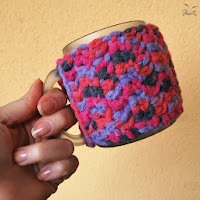 http://www.etsy.com/listing/155290866/crochet-cozy-for-a-mug-made-of-melange?ref=shop_home_active
