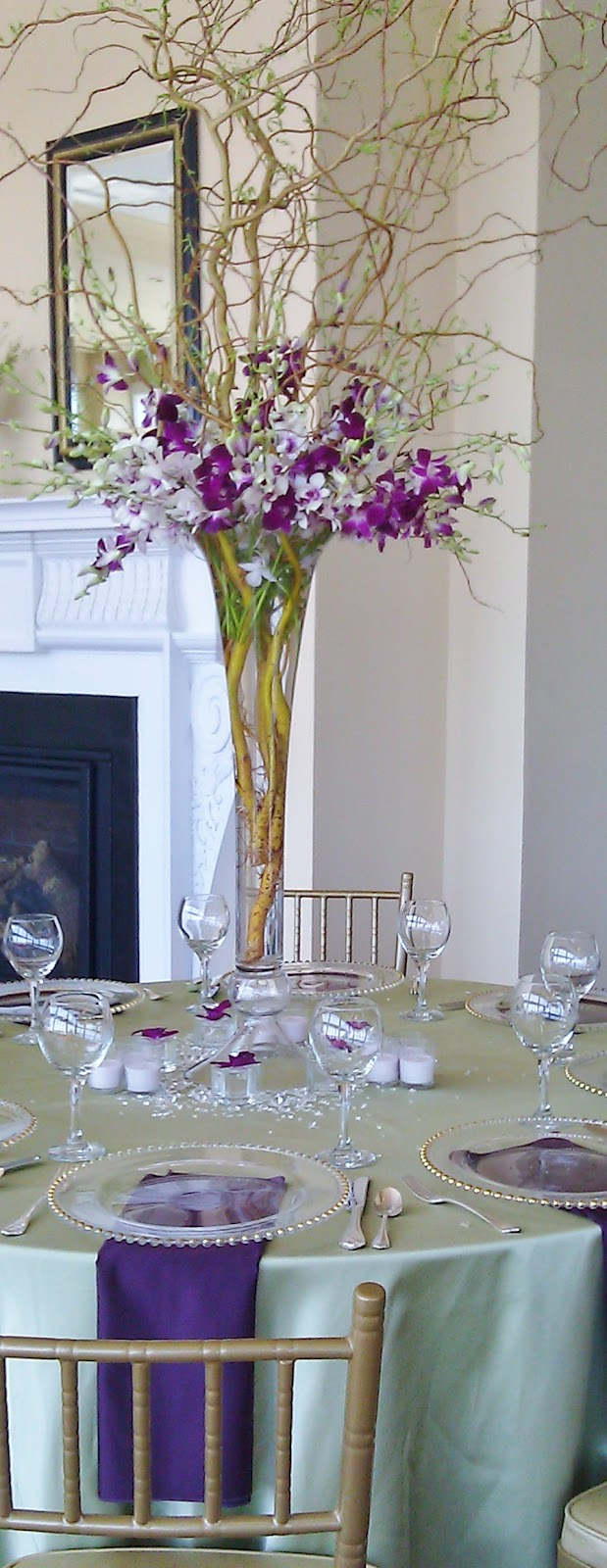 Petals inc weddings flowers more florist in peabody ma tall trumpet vase table centerpiece with orchids bamboo and curly willow flowers for a wedding at the cruiseport in gloucester reviewsmspy