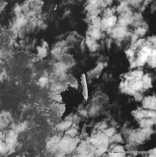 A satellite image of the Costa Concordia wreck.