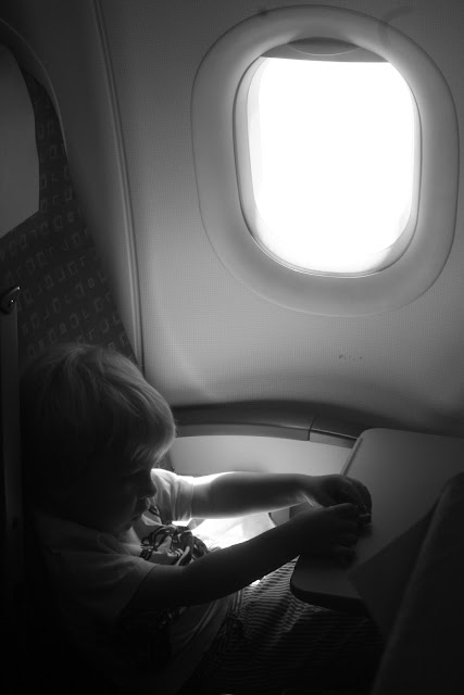 Anton playing with cars on a plane.