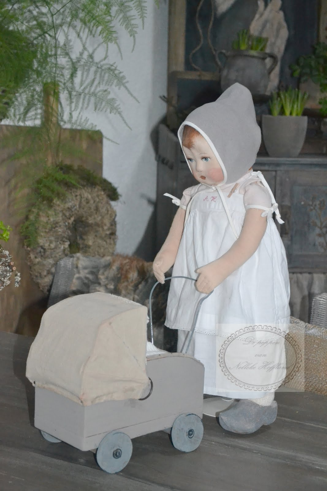 handgemaakte pop en handgemaakt wagentje