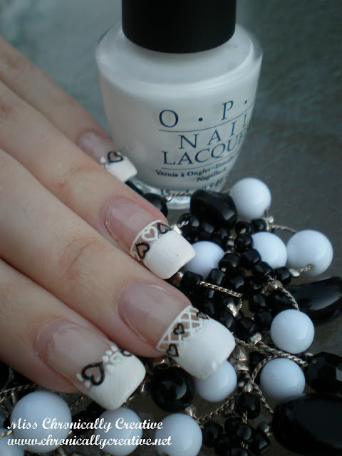 nail art: opi 'alpine snow' black & white heart lace decal french manicure