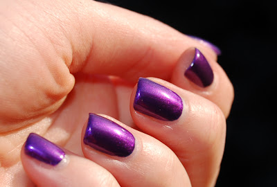 The nail polish Kicks Purple Rain, a purple shimmer nail polish