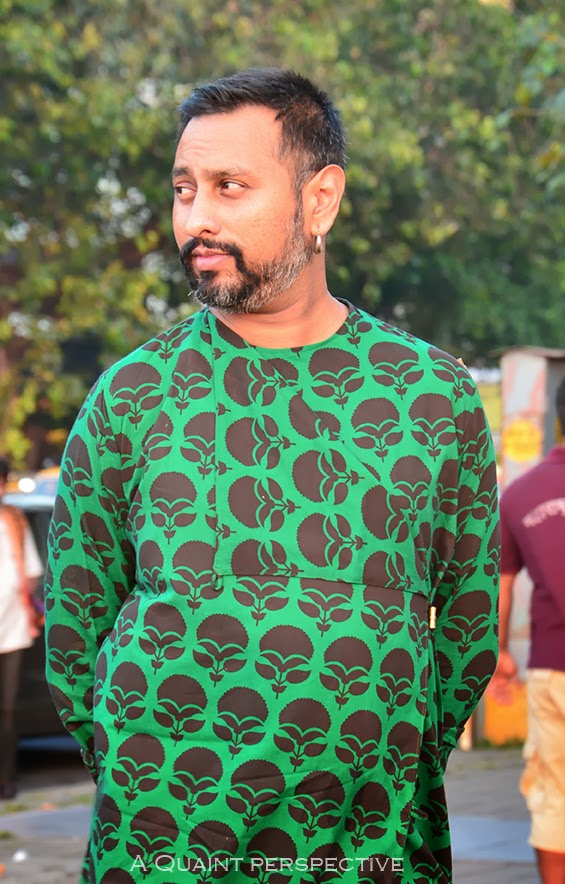 The jewel tone green kurta with overlapping front secured with a metal button