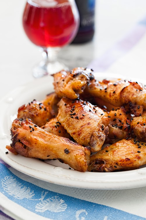 oven baked crispy sweet and spicy chicken wings is a healthier version ...