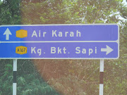 signboard that shows direction to our farm