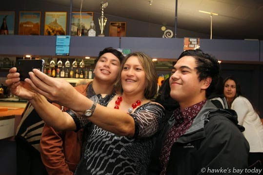 L-R: Wirangi Parata, 16, Meka Whaitiri, Nohorua Parata, 18, take a family selfie at an election night party for the Labour Party in Ikaroa Rawhiti electorate, at Clive Rugby Club, Clive, Hastings. photograph