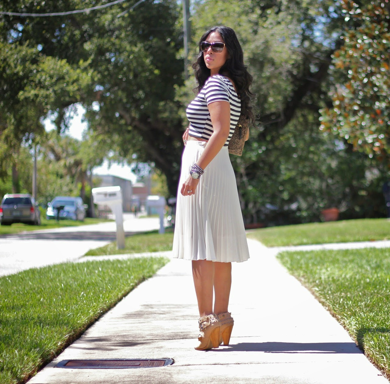 H&M striped crop top pleated white skirt ankle boots leopard clutch DVF chanel sunglasses