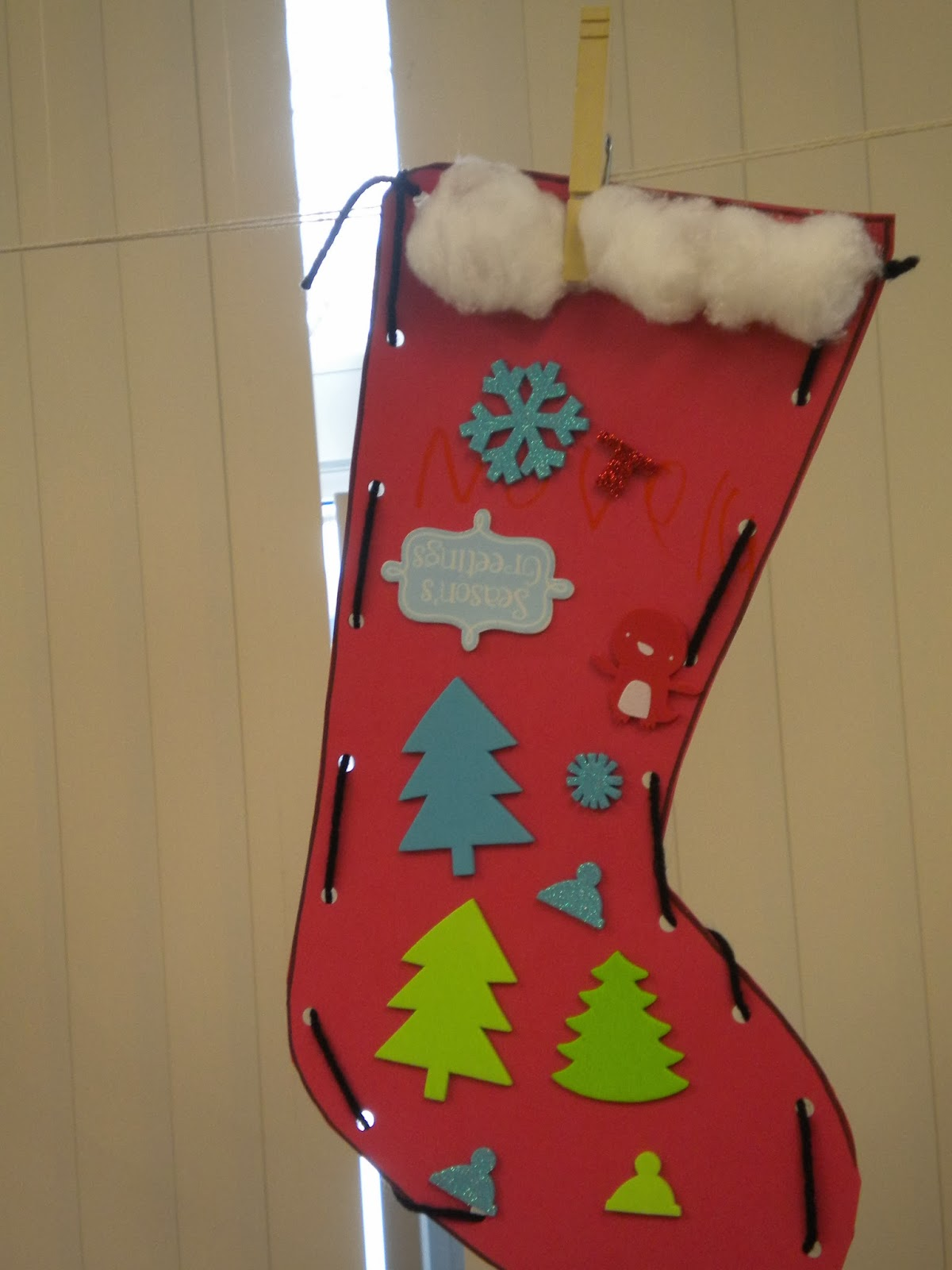 cut red triangles glue a folded coffee filter to the bottom have the kiddos draw a face cut strips in the coffee filter for santas beard