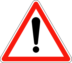 علامة الخطر شكلها متلت محاط بأحمر