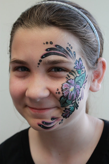 elaborate face paint, flower pattern, colorful flower paint