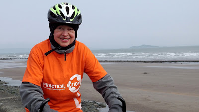 Edinburgh PR agency founder, Penny Haywood Calder of PHPR on her bike at Portobello for charity