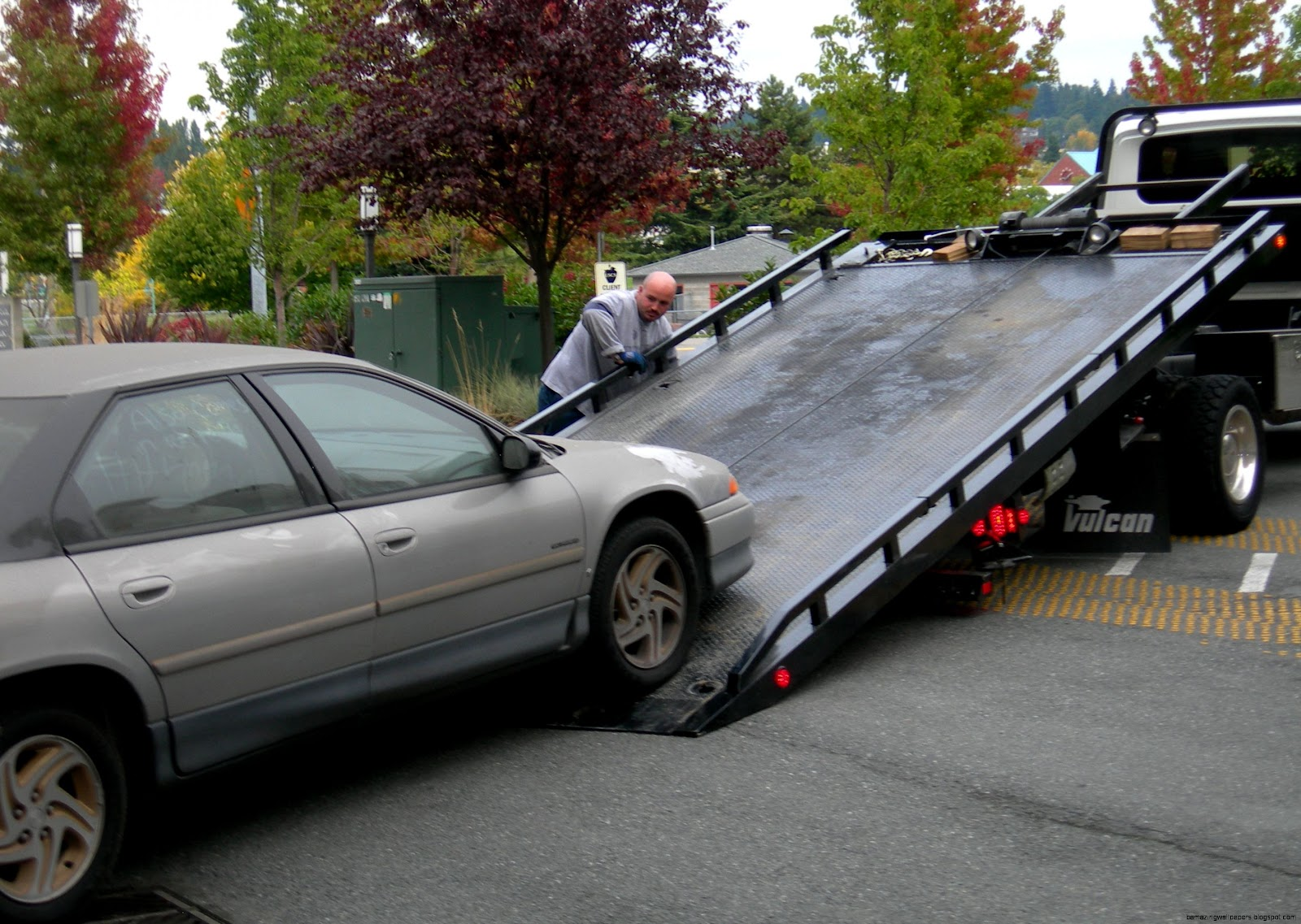 Flatbed Tow Trucks Towing Cars
