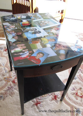 Glass top table with Photo's under the Glass