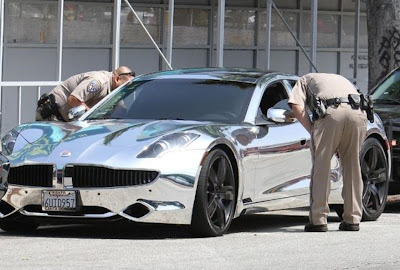 Justin Bieber pulled over in his chrome Fisker Karma Batmobile