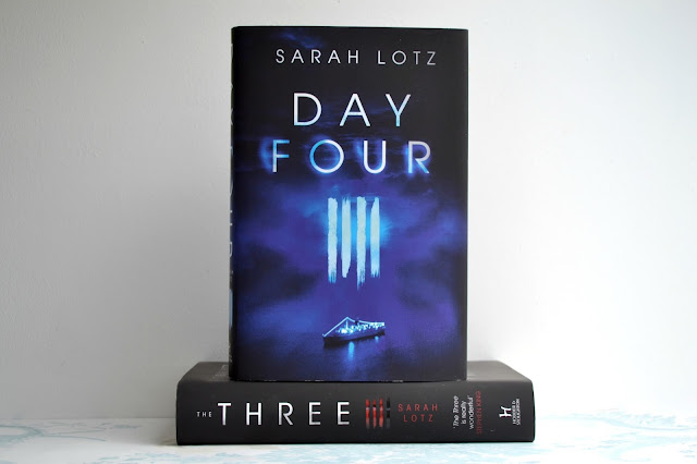 Day Four by Sarah Lotz on top of The Three by Sarah Lotz