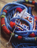 There is nothing better than a small brush to clean the tiny Spaces between the beads of this type of necklace.