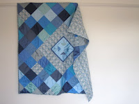Silk and Liberty print quilt with applique flower heads medallion
