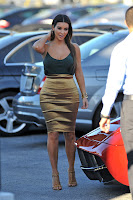 Kim Kardashian gorgeous in a gold outfit
