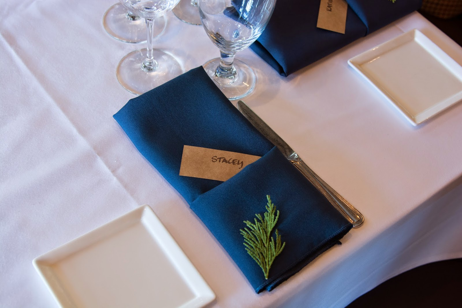 Rustic Table numbers and navy napkins / Take the Cake Event Planning