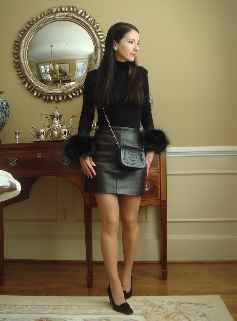 Full body outfit with fur cuffs turned slightly to the side.