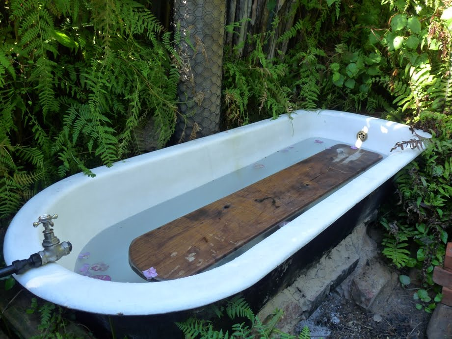 Middle age ramblings creative realm for Outdoor bathtub wood fired