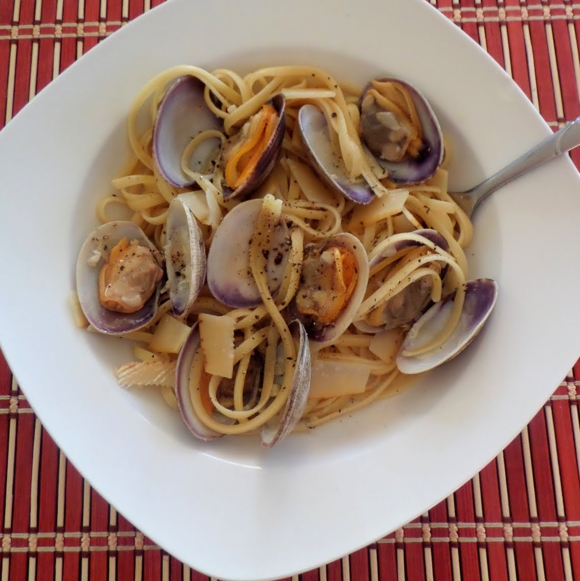 Clam Linguine:  Clams cooked in white wine sauce then tossed with linguine.  A delicious dinner that may look fancy but is really quite simple.