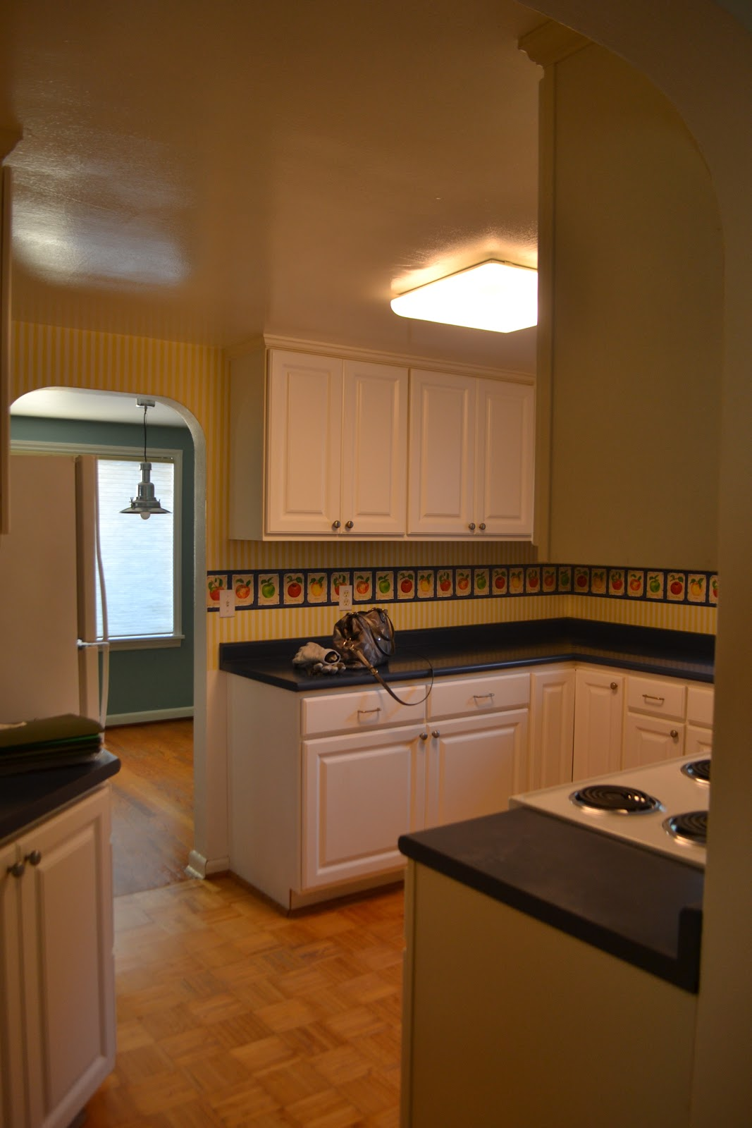 Yes, My Friends, Thatu0027s Multicolored Apple Border On Top Of Yellow And  White Striped Wallpaper. The White Cabinets Arenu0027t Bad At All!