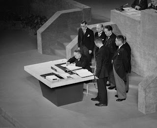 Yoshida and members of the Japanese delegation sign the Treaty.
