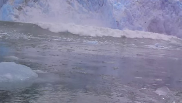 A huge chunk of ice falls into the ocean causing gigantic tidal waves.