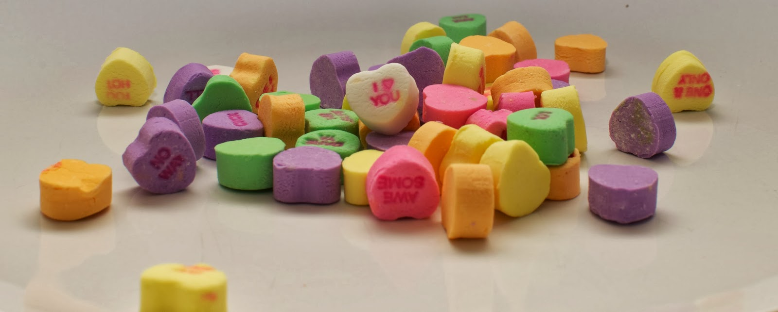 heart shaped candies with messages on white background