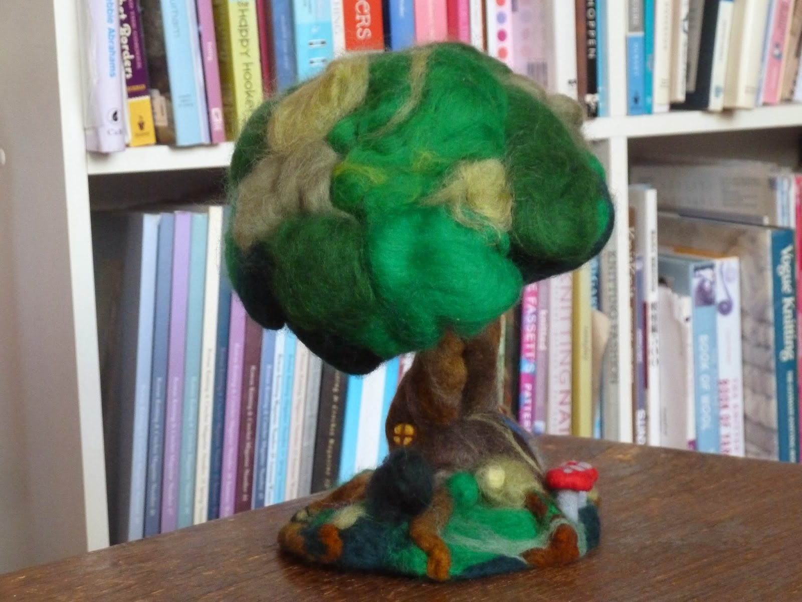 Hand needled felted tree house made of merino rovings