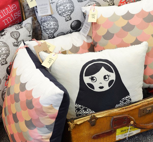 Closeup of screen printed cushions at The Fine Design Market