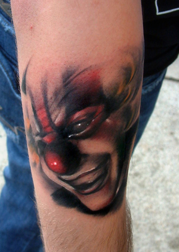 The first of my clown tattoos is this stunning cool tattoo design on the