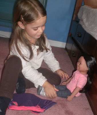 Young girl with her new vinyl play doll.