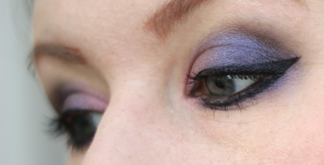 Close up of purple eyes from the side