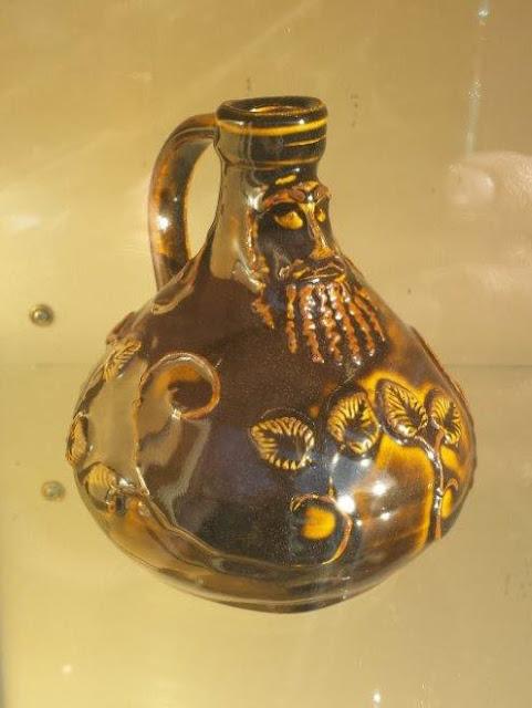 Ceramic Bartmann (Bellarmine) jug in Amber Celadon by Lily L.