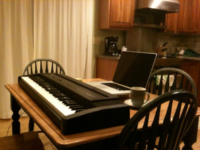 My electronic keyboard set up on the kitchen table, ready for an evening's work.