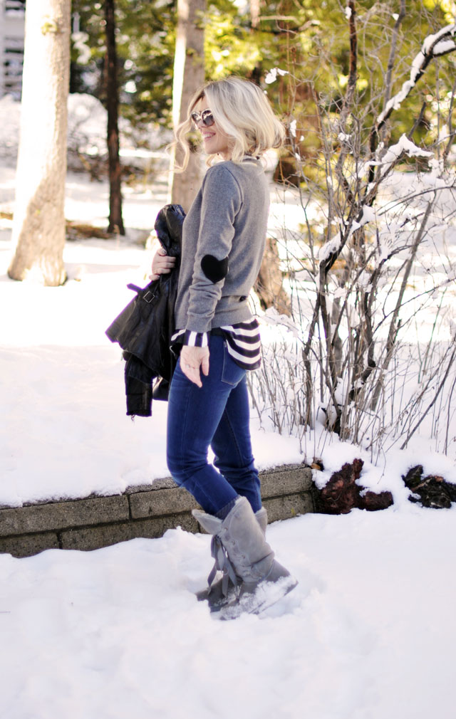 style in the snow, heart elbow patch sweater, striped blouse, jeans