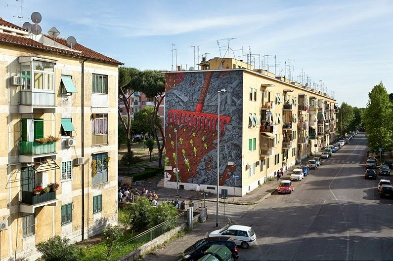Spanish street artist Liquen just finished his first mural for the Sanba festival on the streets of San Basilio, Italy.