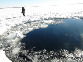 Hole in Russian lake ice caused by meteorite strike