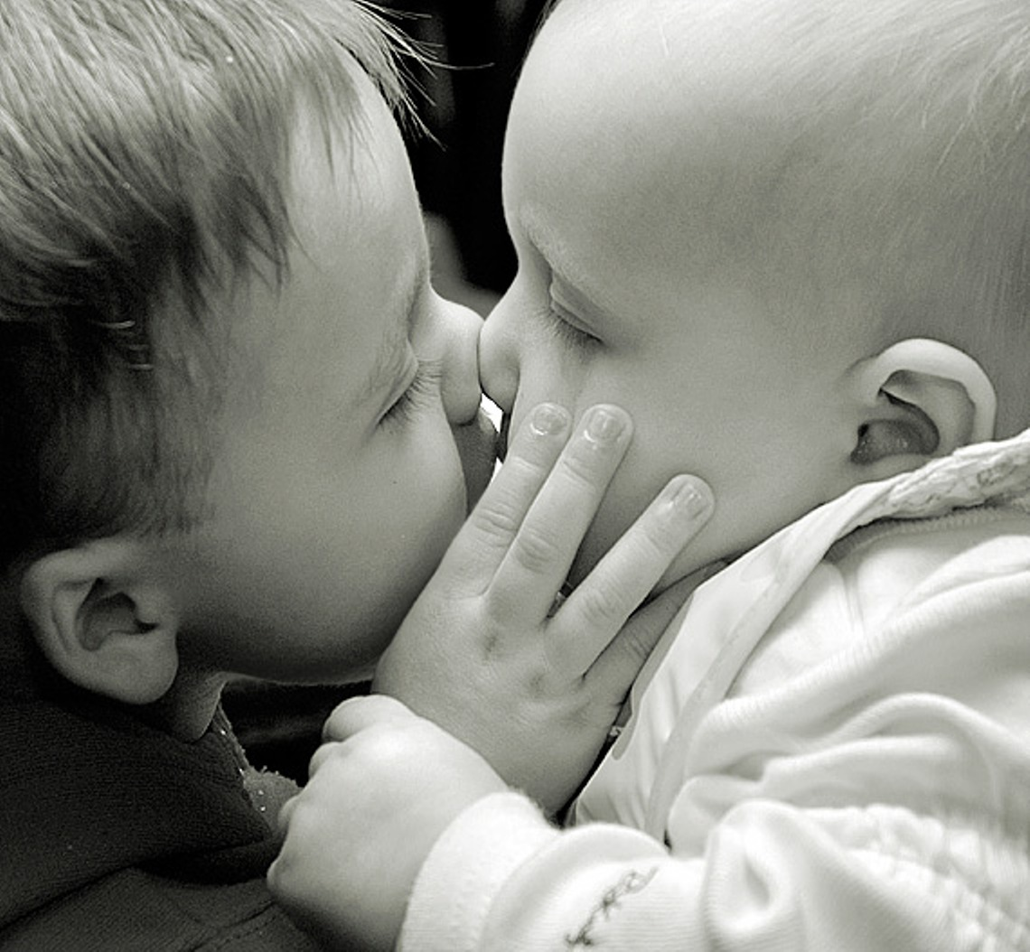 Cute Baby Kissing