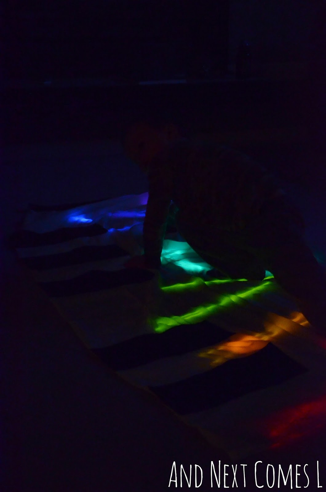 Playing twister on a homemade glowing floor piano from And Next Comes L