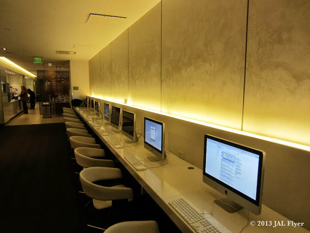 JAL Business Class trip report on JL061 Work area with iMac inside the oneworld business class lounge at LAX TBIT